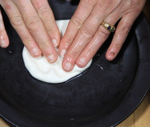 Place the ball on a plate and gently flatten it with your fingers, making it as even as possible